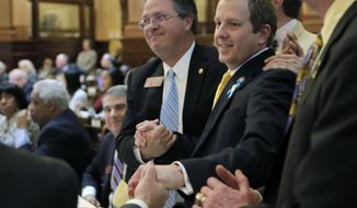 Rep. Bert Reeves, R - Marietta, is congratulated after the passage of HB-159, concerning adoption, in the house. Georgia lawmakers voted Thursday, Feb. 1, 2018, on a compromise over a major overhaul to make adoptions easier in the state. The deal will settle a long-running dispute among legislators over how to improve the state's outdated adoption laws, which hinder the creation of new families. Gov. Nathan Deal and legislative leaders say adoption is a priority for this session. (Bob Andres/Atlanta Journal-Constitution via AP)