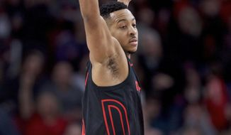 Portland Trail Blazers guard CJ McCollum reacts after making a three-point basket during the first half of an NBA basketball game against the Chicago Bulls in Portland, Ore., Wednesday, Jan. 31, 2018. (AP Photo/Craig Mitchelldyer)