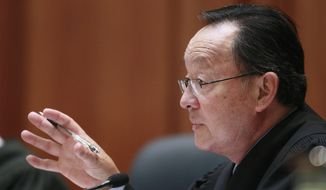 """FILE - In this Nov. 10, 2011 file photo, Associate Justice Ming Chin is shown at the California Supreme Court in San Francisco. The California Supreme Court has expanded the scope of a ballot measure that limits prosecutors from charging juveniles with crimes in adult court. The court ruled unanimously Thursday, Feb. 1, 2018, that Proposition 57 applies to cases that were pending before it took effect. Associate Justice Ming Chin, writing for the court, noted that penalties in adult court can be much more severe so there were """"potentially major consequences for juveniles."""" (AP Photo/Jeff Chiu, File)"""