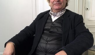 "Frederic Durand-Baissas, a 59-year-old Parisian teacher and art lover, poses during an interview in Paris, Thursday, Feb. 1, 2018.  Durand-Baissas, whose Facebook account was suspended in 2011 after he posted a photo of Gustave Courbet's 1866 painting ""The Origin of the World,"" which depicts female genitalia, is suing the California-based social network Facebook for alleged ""censorship"". (AP Photo/Laurent Rebours)"