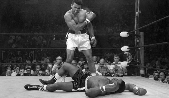 FILE - In this May 25, 1965, file photo, Muhammad Ali stands over Sonny Liston after knocking Liston down during their' heavyweight championship bout in Lewiston, Maine. (AP Photo/John Rooney, File)