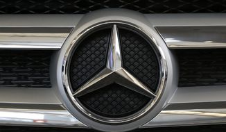FILE - This Thursday, Feb. 11, 2016 file photo shows the Mercedes logo in the grill of a Mercedes 2016 GLE SUV automobile on display at the Auto Show in Pittsburgh. German automaker Daimler AG says Thursday Feb. 1, 2018, its net profit rose 24 percent to a record 10.9 billion euros ($13.5 billion) last year, helped by strong sales of its Mercedes-Benz SUVs and new E-Class luxury sedan. (AP Photo/Gene J. Puskar, File)