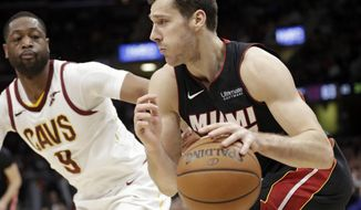 Miami Heat's Goran Dragic (7), from Slovenia, drives past Cleveland Cavaliers' Dwyane Wade (9) in the second half of an NBA basketball game, Wednesday, Jan. 31, 2018, in Cleveland. The Cavaliers won 91-89. (AP Photo/Tony Dejak)