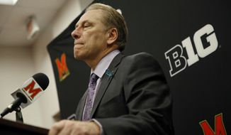 FILE - In this Sunday, Jan. 28, 2018, file photo, Michigan State head coach Tom Izzo speaks at a news conference after an NCAA college basketball game against Maryland in College Park, Md. Izzo has been regarded as one of the most frank and accessible in sports. Larry Nassar and an ESPN report has changed his ways in front of reporters, leaning on mostly scripted statements to dodge questions he can't or doesn't want to answer right now. (AP Photo/Patrick Semansky, File)