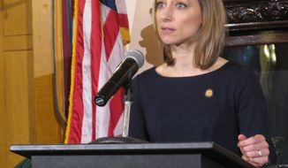 Megan Marchal, president of the Ohio Board of Pharmacy, announces new rules for drug distributors for the reporting of suspicious orders as part of the state's efforts to curb the deadly opioid epidemic, on Thursday, Feb. 1, 2018, in Columbus, Ohio. Marchal said Ohio's new rules are needed because of weakened federal laws. (AP Photo/Andrew Welsh-Huggins)