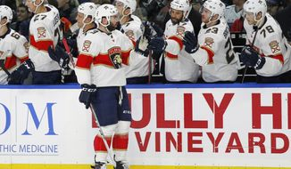 Florida Panthers defenseman Keith Yandle (3) celebrates his goal with teammates during the first period of an NHL hockey game against the Buffalo Sabres, Thursday, Feb. 1, 2018, in Buffalo, N.Y. (AP Photo/Jeffrey T. Barnes)