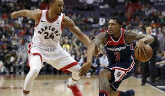 Toronto Raptors forward Norman Powell (24) guards Washington Wizards guard Bradley Beal (3) during the second half of an NBA basketball game Thursday, Feb. 1, 2018, in Washington. The Wizards won 122-119. (AP Photo/Alex Brandon)