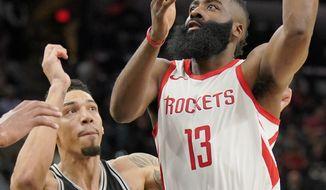 Houston Rockets' James Harden (13) shoots next to San Antonio Spurs' Danny Green during the first half of an NBA basketball game Thursday, Feb. 1, 2018, in San Antonio. (AP Photo/Darren Abate)