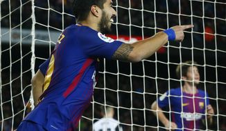 FC Barcelona's Luis Suarez celebrates after scoring during the Spanish Copa del Rey, semifinal, first leg, soccer match between FC Barcelona and Valencia at the Camp Nou stadium in Barcelona, Spain, Thursday, Feb. 1, 2018. (AP Photo/Manu Fernandez)