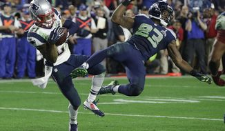 FILE - In this Feb. 1, 2015, file photo, New England Patriots strong safety Malcolm Butler (21) intercepts a pass intended for Seattle Seahawks wide receiver Ricardo Lockette (83) during the second half of the NFL football Super Bowl 49 in Glendale, Ariz. Butler's interception at the goal line that turned what looked like a likely Seattle repeat title into the fourth championship for Tom Brady and the Patriots three years ago might be the most impactful play of any kind in the Super Bowl when it comes to determining the champion. (AP Photo/Kathy Willens, File)