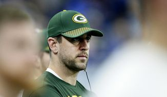 FILE - In this Dec. 31, 2017 photo, Green Bay Packers quarterback Aaron Rodgers watches from the sideline during the second half of an NFL football game against the Detroit Lions in Detroit. Rodgers wants to follow Tom Brady's path and still chuck it when he's in his 40s. He also accepts that in today's NFL he might again follow Brett Favre's footsteps and one day don something other than the green and gold.  (AP Photo/Duane Burleson, File)