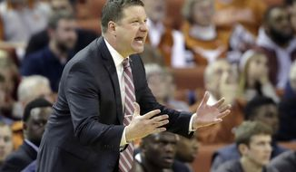 FILE - In this Jan. 17, 2018, file photo, Texas Tech head Chris Beard calls to his players during the second half of an NCAA college basketball game against Texas, Wednesday, Jan. 17, 2018, in Austin, Texas. After Tubby Smith's sudden departure from the Red Raiders nearly two years ago, Beard was considered a perfect fit. They are now in the Top 10 and near the top of the Big 12 Conference standings.  (AP Photo/Eric Gay, File)
