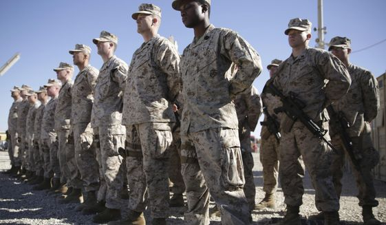 U.S. Marines watch during the change of command ceremony at Task Force Southwest military field in Shorab military camp of Helmand province, Afghanistan. (AP Photo/Massoud Hossaini, File)