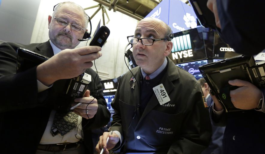 Traders Robert Moran, left, and Andrew Silverman work on the floor of the New York Stock Exchange, Friday, Feb. 2, 2018. Technology companies were leading stocks broadly lower in early trading, extending the market's slide into a second day. (AP Photo/Richard Drew)