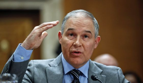 In this Jan. 30, 2018, photo, Environmental Protection Agency administrator Scott Pruitt testifies before the Senate Environment Committee on Capitol Hill in Washington. (AP Photo/Pablo Martinez Monsivais)