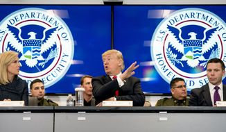President Donald Trump, accompanied by Homeland Security Secretary Kirstjen Nielsen, left, and U.S. Customs and Border Protection Acting Commissioner Kevin McAleenan, right, speaks during a roundtable at the Customs and Border Protection National Targeting Center in Reston, Va., Friday, Feb. 2, 2018. (AP Photo/Andrew Harnik)