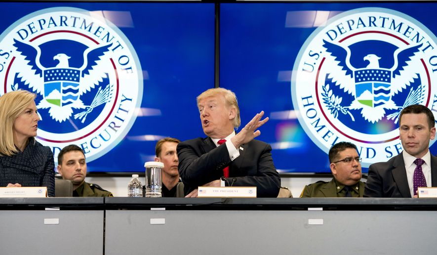 In this file photo, President Donald Trump, accompanied by Homeland Security Secretary Kirstjen Nielsen, left, and U.S. Customs and Border Protection Acting Commissioner Kevin McAleenan, right, speaks during a roundtable at the Customs and Border Protection National Targeting Center in Reston, Va., Friday, Feb. 2, 2018. (AP Photo/Andrew Harnik) **FILE**