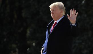 President Donald Trump waves as he leaves the White House in Washington, Friday, Feb. 2, 2018, en route to the Customs and Border Protection National Targeting Center in Sterling, Va. (AP Photo/Manuel Balce Ceneta)