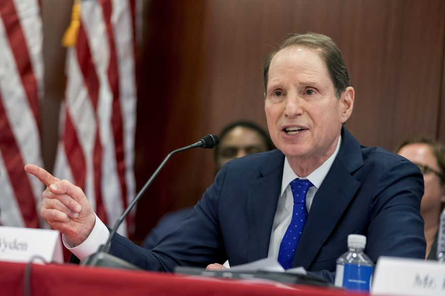 Sen. Ron Wyden of Oregon, the top Democrat on the Senate Finance Committee, speaks during a House and Senate conference on Capitol Hill in Washington on Dec. 13, 2017. (Associated Press)