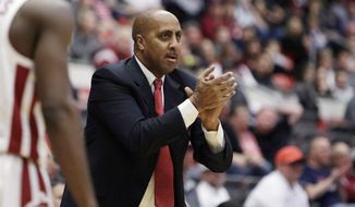 FILE - In this Wednesday, Jan. 31, 2018, file photo, Arizona associate head coach Lorenzo Romar reacts during the first half of an NCAA college basketball game against Washington State in Pullman, Wash.  Romar is uncertain about what will happen Saturday. He spent 15 seasons as the head coach at Washington, but now will walk into Huskies home gym as the opponent. Romar is now an assistant for No. 9 Arizona, which faces Washington on Saturday. (AP Photo/Young Kwak, File)