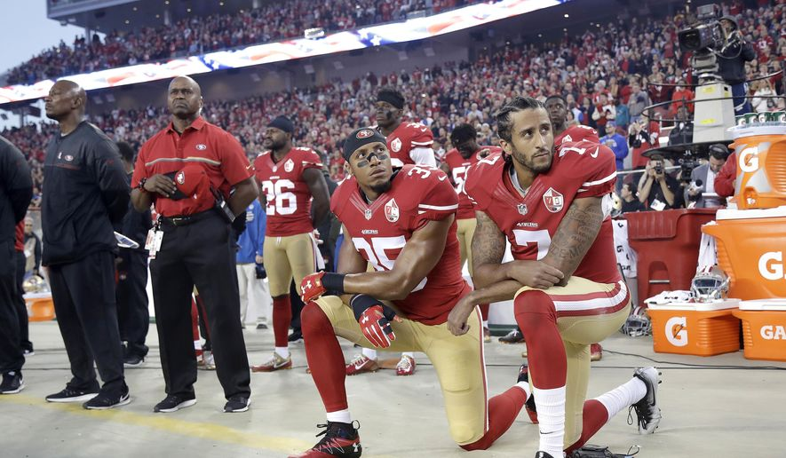 In this Sept. 12, 2016, file photo, San Francisco 49ers safety Eric Reid (35) and quarterback Colin Kaepernick (7) kneel during the national anthem before an NFL football game against the Los Angeles Rams in Santa Clara, Calif. (AP Photo/Marcio Jose Sanchez, File)