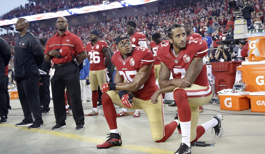 FILE - In this Sept. 12, 2016, file photo, San Francisco 49ers safety Eric Reid (35) and quarterback Colin Kaepernick (7) kneel during the national anthem before an NFL football game against the Los Angeles Rams in Santa Clara, Calif. Despite their vastly divergent methods, Colin Kaepernick and LeBron James helped set a stake in the ground, declaring to athletes across all sports that their platforms could be used for more than fun and games in the 21st century. (AP Photo/Marcio Jose Sanchez, File)