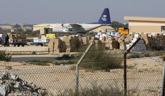 FILE - In this file photo taken o Dec. 29, 2008. nDonated medical supplies are seen at El-Arish airport waiting to be shipped to Gaza through the Egyptian border crossing terminal in Rafah, at the Sinai town of El-Arish, Egypt. The Egyptian army is bulldozing homes and olive groves in Feb. 2018 to build a buffer zone around the main airport in its troubled North Sinai Province, where Islamic State militants nearly killed the defense and interior ministers in December. The operation, described by residents and military officials, will displace thousands of residents from the hamlets around el-Arish airport, who are being moving to nearby cities where the army says they will receive compensation. (AP Photo/Nasser Nasser, File)