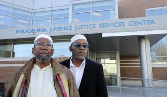 ADVANCE FOR RELEASE SATURDAY, FEBRUARY 3, 2018 Darryl Goodman poses for a photo with his father Bruce Goodman outside the JJSC, the city's youth detention center, in Philadelphia, where they have both been volunteers Tuesday, Nov. 28, 2017. (David Swanson/The Philadelphia Inquirer via AP)