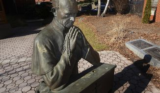 A statue of the late Rev. Patrick Peyton at the Saint Peter's Cathedral Prayer Garden in Scranton. The young Irish immigrant who arrived in Scranton and found work as a custodian at St. Peter's Cathedral in 1928 could not have known he was about to embark on a path that would make him one of the most influential and beloved Roman Catholic priests of the 20th century. Ninety years later, that road has led the late Rev. Patrick Peyton, C.S.C., to the threshold of sainthood.(Butch Comegys/The Times & Tribune via AP)