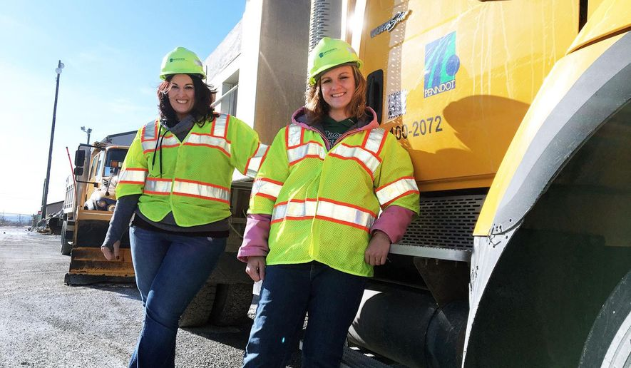 Krisa Walls, left, and Tish Libertino, right, both operate snow plow truck for PennDOT District 12 for Fayette County.  The two former bus drivers have shifted gears to drive and operate snowplow trucks for the Pennsylvania Department of Transportation. Walls of Georges Township was looking for a job to bring in a second income into her home when she decided to apply. The stay-at-home mom raised three children over 20 years, and her last job was driving a school bus. (Mark Hofmann /Herald-Standard via AP)