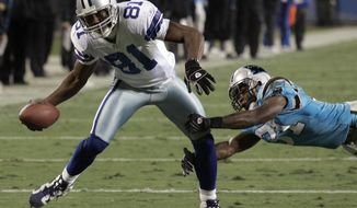 FILE - In this Dec. 22, 2007, file photo, Dallas Cowboys' Terrell Owens (81) pulls away from Carolina Panthers' Richard Marshall (31) as Owens runs for a touchdown after a reception during the first quarter of an NFL football game in Charlotte, N.C. Owens, Randy Moss and Isaac Bruce, among others, are on the ballot in voting Saturday, Feb. 3, for the Pro Football Hall of Fame. (AP Photo/Chuck Burton) ** FILE **
