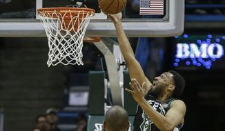 Milwaukee Bucks' Jabari Parker, in his season debut, shoots a layup during the first half of the team's NBA basketball game against the New York Knicks on Friday, Feb. 2, 2018, in Milwaukee. (AP Photo/Tom Lynn)