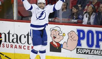 Tampa Bay Lightning's Cory Conacher celebrates his goal against the Calgary Flames during the third period of an NHL hockey game Thursday, Feb. 1, 2018, in Calgary, Alberta. (Jeff McIntosh/The Canadian Press via AP)