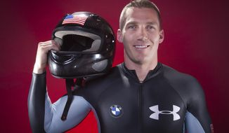 FILE - In this Sept. 30, 2013, file photo, United States Olympic Bobsledder Chris Fogt poses for a portrait at the 2013 Team USA Media Summit in Park City, Utah. For whatever reason, sliding sports have always gotten tons of attention from the military, and the team that is wearing red, white and blue in Korea has plenty of people who wear the flag at work as well. Fogt, an Army captain, has done multiple tours overseas. (AP Photo/Carlo Allegri, File)