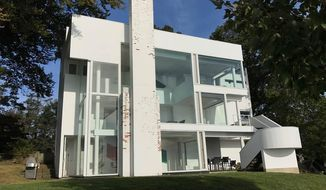 This photo provided by Chuck Smith shows a modernist home designed by architect Richard Meier and built in 1967 has been listed for sale in Darien, Conn.. The family that owned it for over 50 years is hoping the seller will honor its pedigree and not make dramatic alterations. (Chuck Smith via AP)