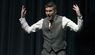 FILE - In this Oct. 19, 2017 file photo, white nationalist Richard Spencer tries to get students to shout louder as they clash during a speech at the University of Florida in Gainesville. The University of Cincinnati is asking a federal judge to dismiss a lawsuit filed by the organizer for white nationalist Spencer's campus tour, calling it meritless. The lawsuit filed in Jan. 2018 says the school won't rent space for Spencer to speak on campus unless a nearly $11,000 security fee is paid. (AP Photo/Chris O'Meara, File)