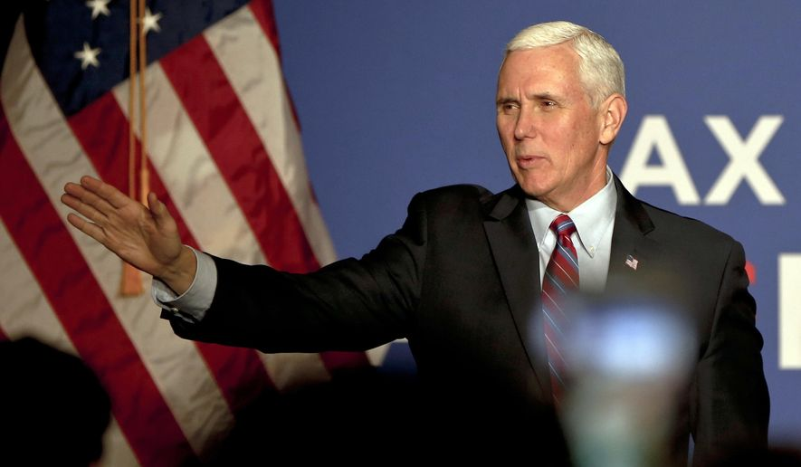 Vice President Mike Pence waves as he arrives for an America First Policies Event, Friday, Feb. 2, 2018, in Pittsburgh. (AP Photo/Keith Srakocic)