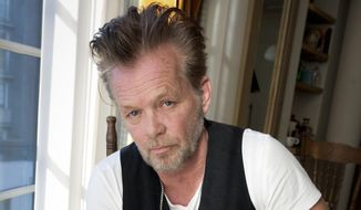 """In this Sept. 22, 2014, file photo, singer-songwriter John Mellencamp poses for a portrait to promote his 22nd album """"Plain Spoken"""" at the Greenwich Hotel in New York. (Photo by Amy Sussman/Invision/AP, File)"""