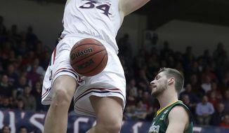 Saint Mary's (Cal.) center Jock Landale (34) dunks over San Francisco center Jimbo Lull (5) during the second half of an NCAA college basketball game in Moraga, Calif., Thursday, Feb. 1, 2018. (AP Photo/Jeff Chiu)