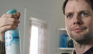 This photo provided by Febreze shows a scene from the company's Super Bowl spot. For the 2018 Super Bowl, marketers are paying more than $5 million per 30-second spot to capture the attention of more than 110 million viewers. (Courtesy of Febreze via AP)
