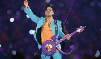 In this Feb. 4, 2007, file photo, Prince performs during the halftime show at the Super Bowl XLI football game at Dolphin Stadium in Miami. (AP Photo/Chris O'Meara, File)