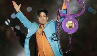 In this Feb. 4, 2007 file photo, Prince performs during halftime of the Super Bowl XLI football game in Miami.  (AP Photo/Chris O'Meara, File) **FILE**