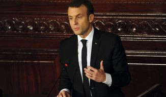 Emmanuel Macron addresses the Tunisian parliament in Tunis, Thursday, Feb.1 2018. Macron is on a two-day visit to Tunisia, a budding democracy that is struggling economically while contending with Islamic extremists. (AP Photo/Hassene Dridi)