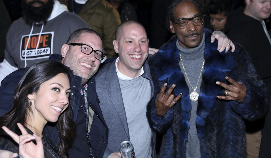 Snoop Dogg, far right, poses with fans during the EA Sports Bowl at The Armory on Thursday, Feb. 1, 2018, in Minneapolis. (Photo by Omar Vega/Invision/AP)
