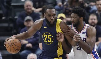 Indiana Pacers' Al Jefferson is defended by Philadelphia 76ers' Joel Embiid during the first half of an NBA basketball game, Saturday, Feb. 3, 2018, in Indianapolis. (AP Photo/Darron Cummings)