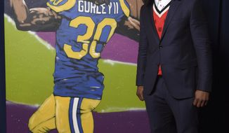 In this photo provided by the NHL, Todd Gurley of the Los Angeles Rams poses backstage with his portrait at the 7th Annual NFL Honors at the Cyrus Northrop Memorial Auditorium on Saturday, Feb. 3, 2018, in Minneapolis. (Peter Barreras/NFL via AP)