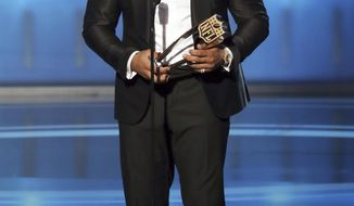 In this photo provided by the NFL, Aaron Donald of the Los Angeles Rams accepts the award for The Associated Press NFL Defensive Player of the Year presented by Old Spice at the 7th Annual NFL Honors at the Cyrus Northrop Memorial Auditorium on Saturday, Feb. 3, 2018, in Minneapolis. (Michael Zorn/NFL via AP)