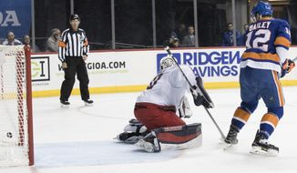 New York Islanders right wing Josh Bailey (12) scores a goal past Columbus Blue Jackets goaltender Joonas Korpisalo (70) during the second period of an NHL hockey game, Saturday, Feb. 3, 2018 in New York. (AP Photo/Mary Altaffer)