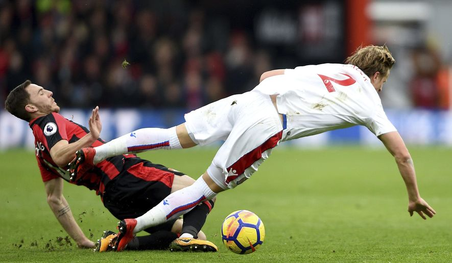 Bournemouth's Dan Gosling left, tackles Stoke City's Moritz Bauer, during the English Premier League soccer match between Bournemouth and Stoke City,  at the Vitality Stadium, in Bournemouth, England, Saturday, Feb. 3, 2018. (Daniel Hambury/PA via AP)