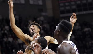 Connecticut's Isaiah Whaley, top, fights for a rebound in the first half of an NCAA college basketball game against Cincinnati, Saturday, Feb. 3, 2018, in Storrs, Conn. (AP Photo/Stephen Dunn)